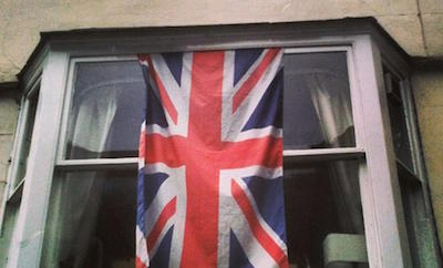 S05PR9 Union Jack flag hanging in a window in Salisbury, Wiltshire