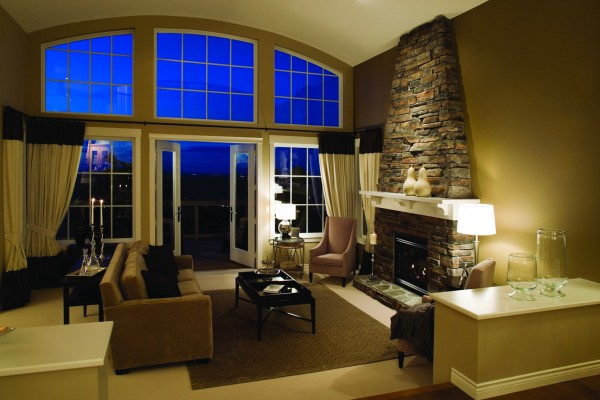 Simonton vinyl replacement geometric window in living room with high ceilings