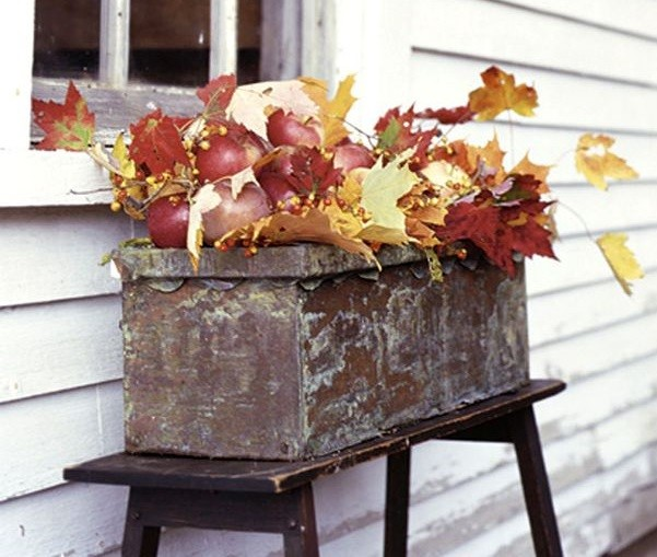 Adding fall leaves to your display is an easy way to boost your fall curb appeal.