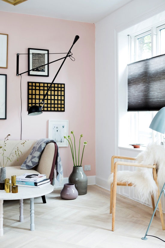 Rose Quartz and Serenity, the 2016 colors of the year, highlight this stunning living room.