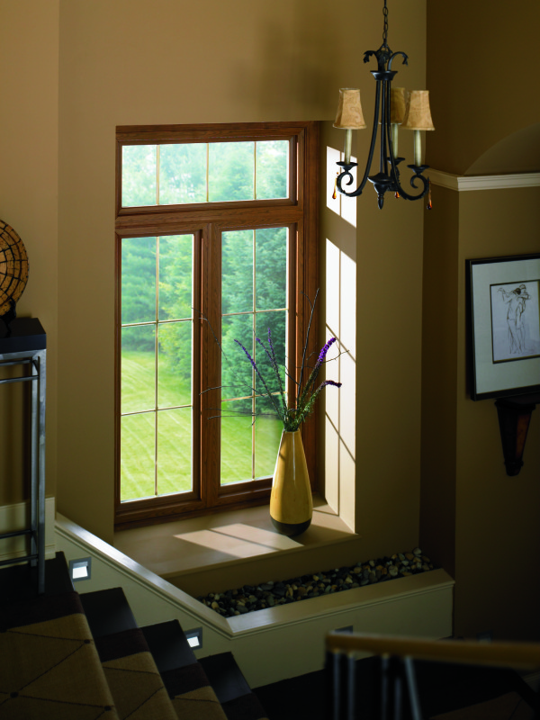 What is the cost of wood windows vs vinyl windows?