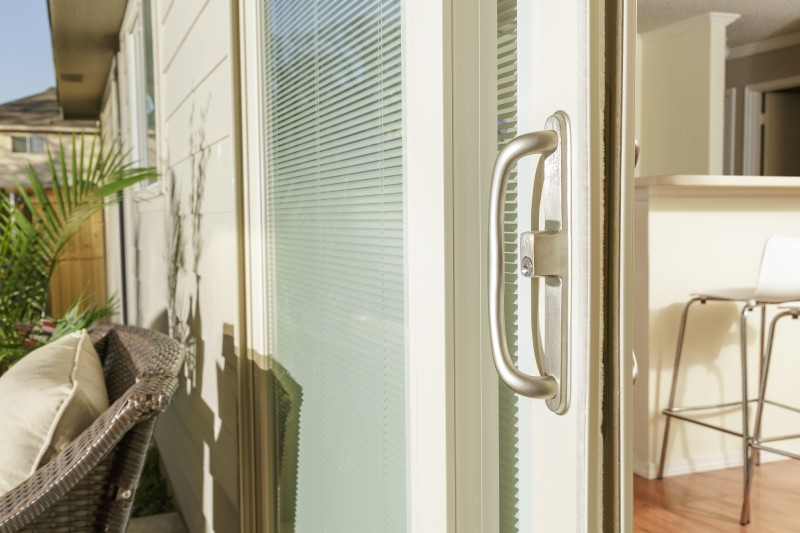 Patio door hardware in satin.