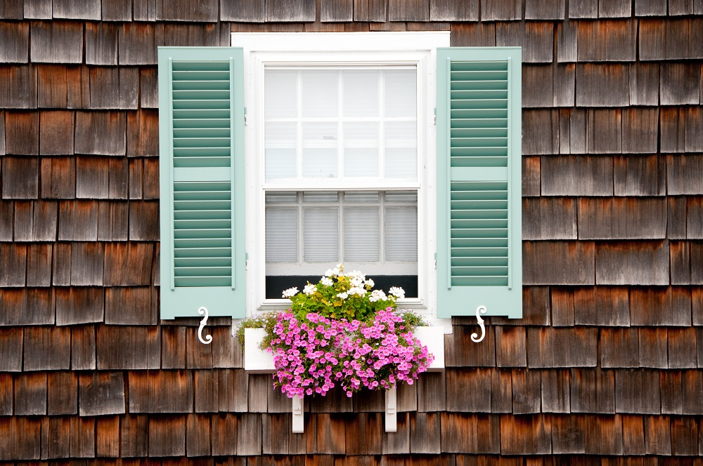 Wood window boxes are a great way to add curb appeal to your home.