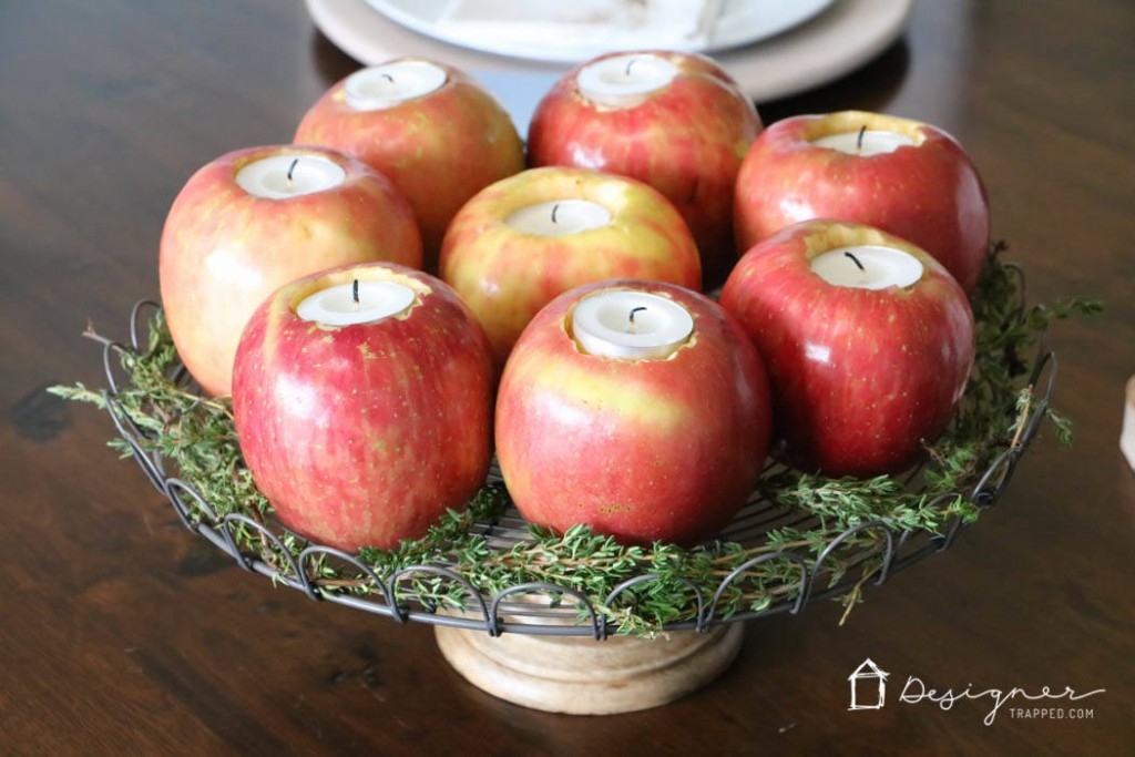Make your own apple votives to dress up your Thanksgiving table. Find more Thanksgiving decorating ideas here.