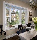 Extra seating from a unique style of bay window in a classic dining room
