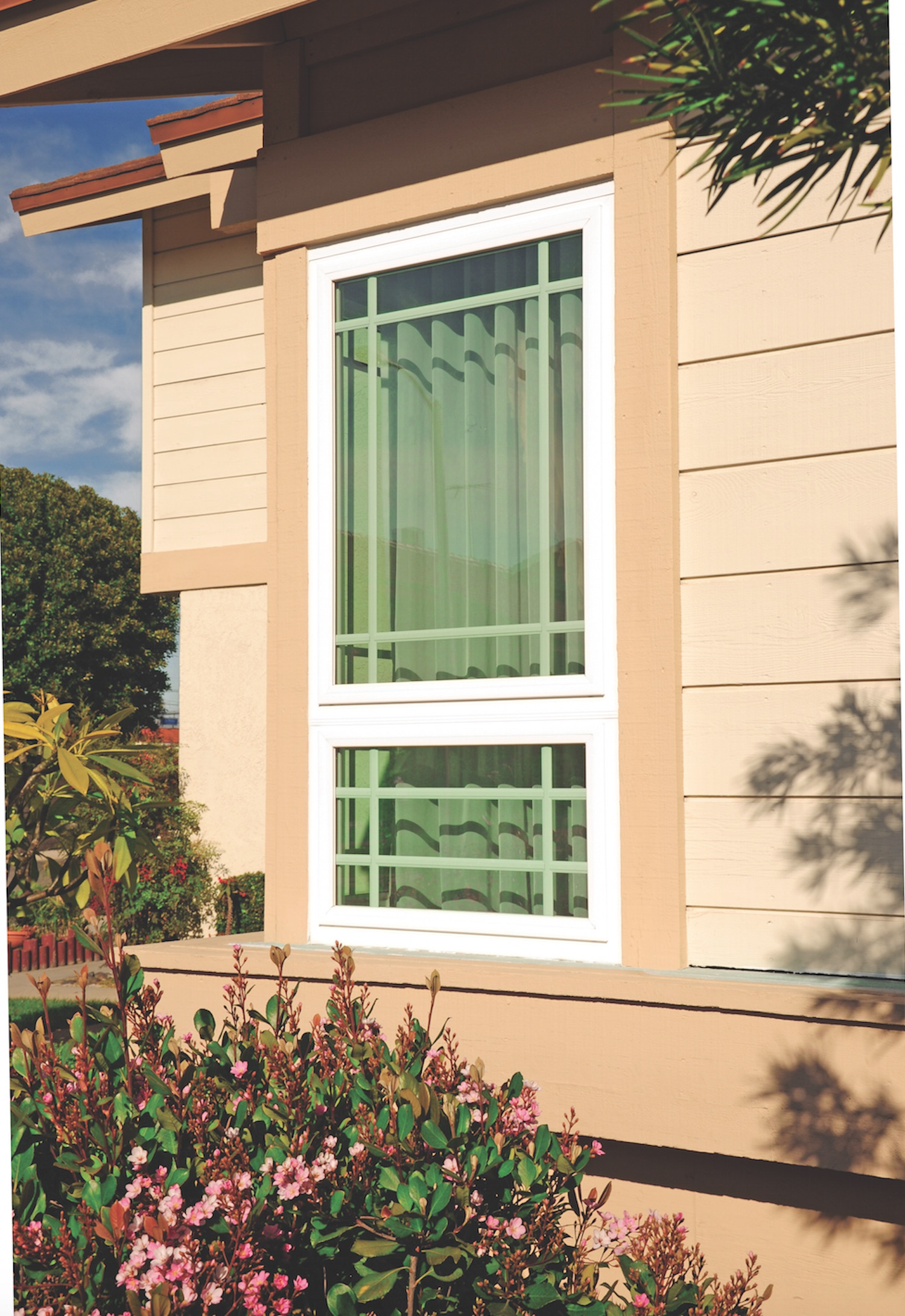 Exterior Of Awning Window On Light Brown House