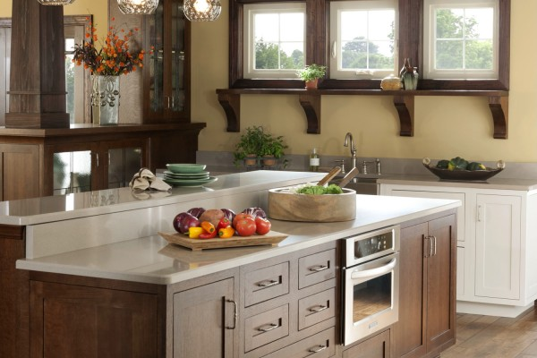 Farm house kitchen with triple awning vinyl windows bordered with dark wood above sink