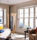 Bow window in a traditional bedroom with lots of natural lighting.