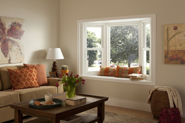 Bay window with seating in warm living room
