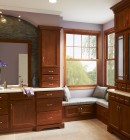 Double hung vinyl windows bring in natural light from the cozy bathroom nook