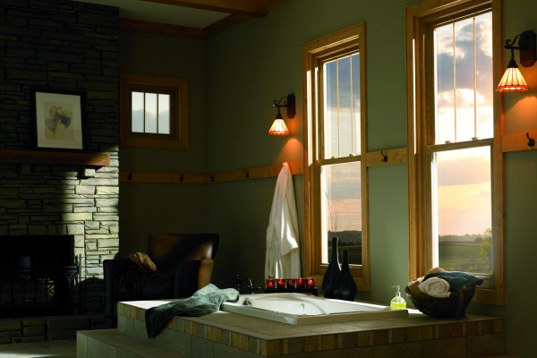 Rustic living room brings sunset in from double hung vinyl windows with a woodgrain interior