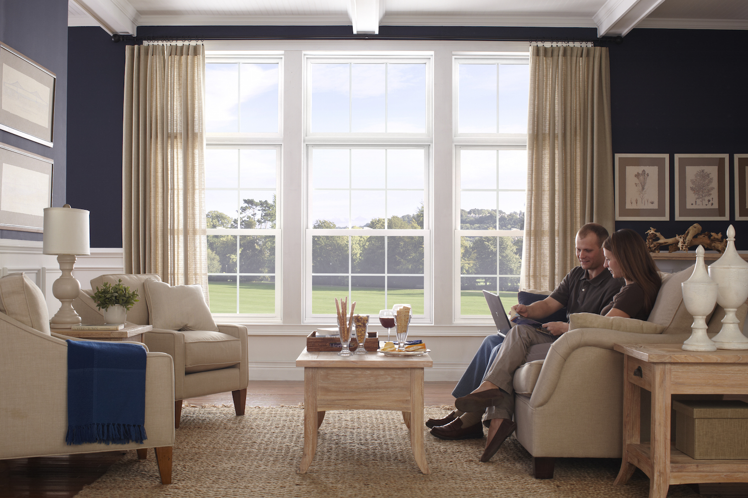 Interior view of living room with colonial grid double hung windows