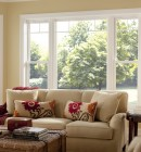 Large double hung and picture windows in brightly lit living room.
