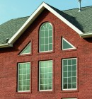 Simonton Geometric Vinyl Replacement Windows on brick house