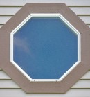 Exterior view of traditional octagonal geometric vniyl replacement window