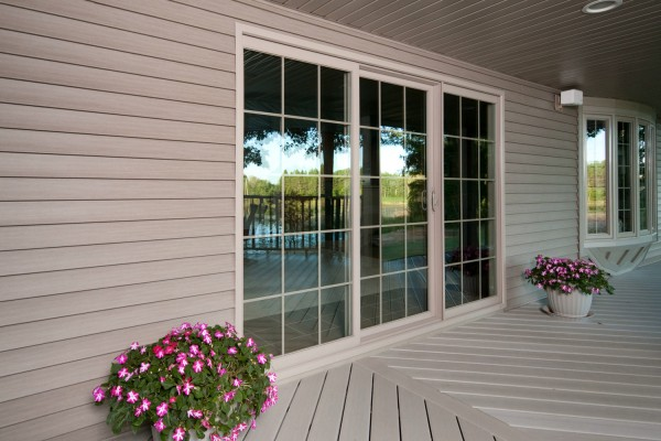 3-lite sliding patio vinyl replacement door with colonial grid pattern view from outside porch
