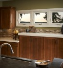 Three awning windows in a warm, contemporary kitchen