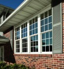 Exterior view of brick house with four double hung windows