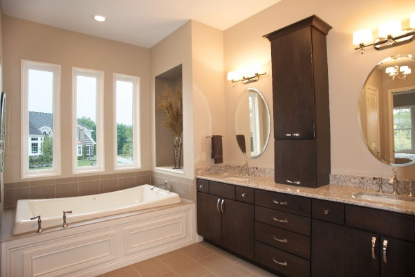 Vinyl replacement picture window trio in elegant bathroom above bathtub