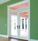 Swinging patio door in bright green wall