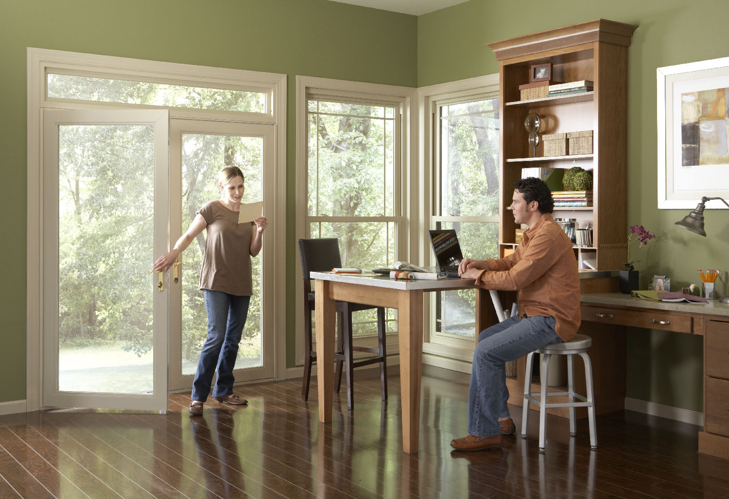 Swinging Patio Door In Home Office Leading To Backyard
