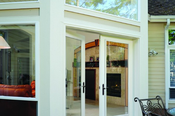 Beautiful patio swinging doors leading inside from outdoor patio