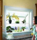 Garden vinyl window in kitchen above counter expands the room with a view and serves as added display area