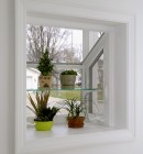 Interior of garden window holding plants