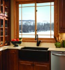 Wooden slider window above kitchen sink