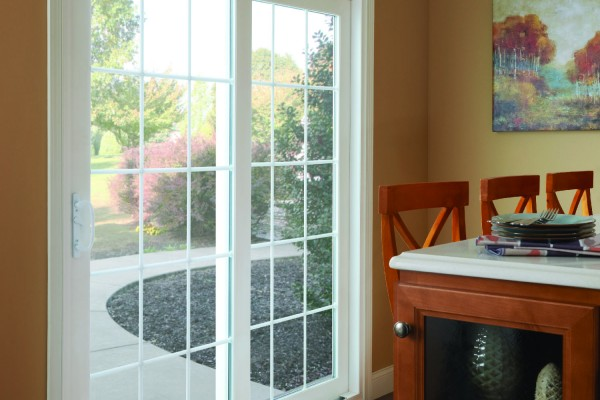 Sliding patio doors in dining room leading to backyard patio