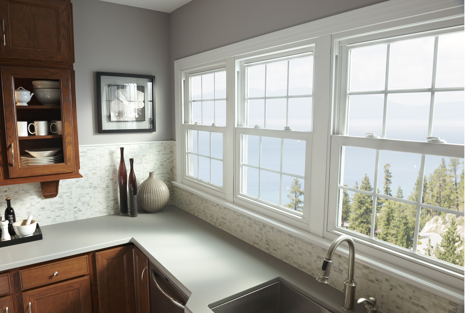 Three double hung vinyl windows over a sink in a contemporary kitchen