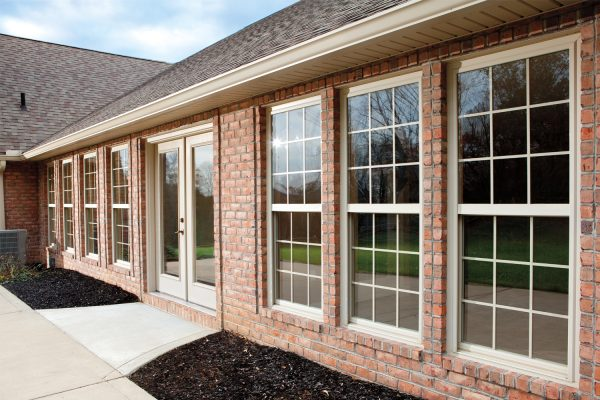 Exterior view of seven single hung windows on brick house