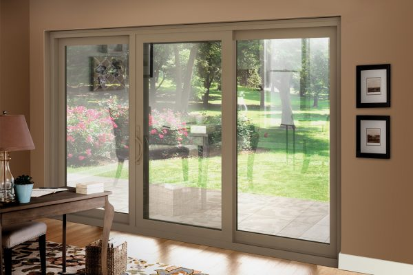 Driftwood vinyl 3-lite sliding patio door in an office