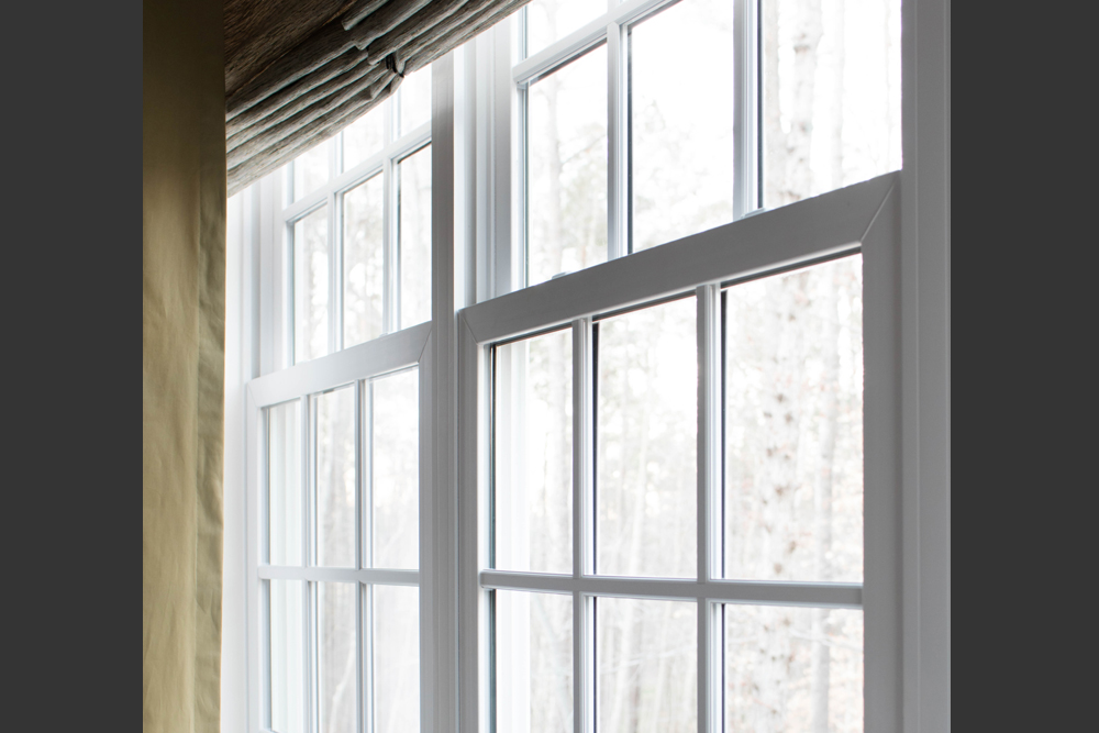 On double hung windows, an overlapping, interlocking meeting rail creates a tight, weather-resistant seal